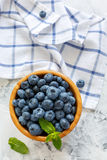 Blueberries and mint leaves in a wooden bowl. Royalty Free Stock Photo