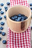 Blueberries in mortar on red towel. With nice background Royalty Free Stock Photo