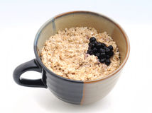Blueberries and oatmeal Stock Photo