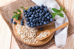 Blueberries with oats on a wooden background Royalty Free Stock Photo