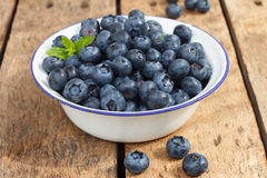 Blueberries. Organic Blueberries on wooden table Royalty Free Stock Photo