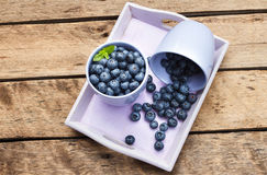 Blueberries. Organic Blueberries on wooden table Royalty Free Stock Photography