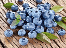 Blueberries over old table. Stock Photos