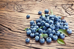 Blueberries over old wooden table. Stock Photography