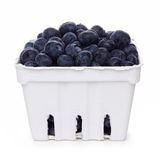Blueberries in a paper carton isolated on white. Fresh blueberries in a white paper carton isolated on a white background Stock Image