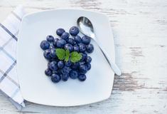 Blueberries on plate Royalty Free Stock Images