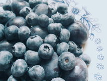Blueberries and plums lying on a plate Royalty Free Stock Photo