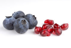 Blueberries and pomegranate Royalty Free Stock Images