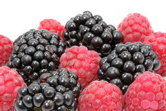 Blueberries and raspberries. On a white background Royalty Free Stock Photos