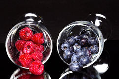 Blueberries and raspberries. In glass Stock Photography