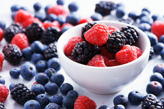 Blueberries, raspberries and black berries. fresh berries. On white background Royalty Free Stock Photography
