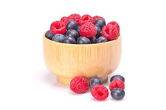 Blueberries and raspberries in a bowl Royalty Free Stock Image