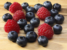 Blueberries and Raspberries Royalty Free Stock Photos
