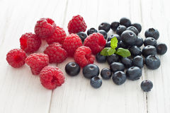 Blueberries and raspberries. With mint Stock Images