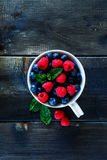 Blueberries and raspberries Stock Images