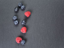 Blueberries and raspberries on slate surface from. Above, copy space Stock Photography