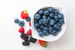 Blueberries raspberries strawberries blackberries Royalty Free Stock Photos