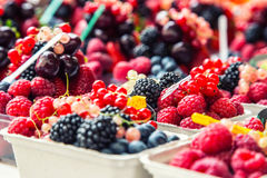 Blueberries, raspberries, strawberries, cherries Forest fruits. Gardening ,agriculture,harvest and forest concept. Berry fruits at a marketplace Blueberries Stock Photo