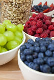 Blueberries, Raspberries, Strawberries, Grapes. Bowls of healthy breakfast blueberries, raspberries, grapes, strawberries and granola or muesli, the focus is on stock photos