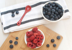Blueberries and raspberries top view Royalty Free Stock Photos