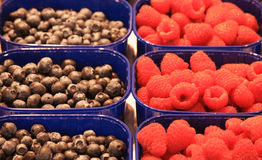 Blueberries and raspberries. In traditional market royalty free stock photos