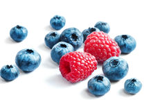 Blueberries and raspberries on white background. Stock Images