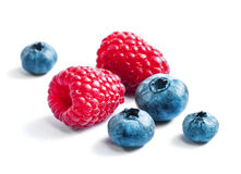 Blueberries and raspberries on white background. Close up, top view, high resolution product. Harvest Concept Stock Photo