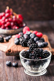 Blueberries and raspberries on a wooden background. Blueberries and raspberries on wooden background berry mix Royalty Free Stock Image