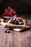 Blueberries and raspberries on a wooden background. Blueberries and raspberries on wooden background berry mix Stock Image