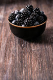 Blueberries and raspberries on a wooden background. Blueberries and raspberries on wooden background berry mix Royalty Free Stock Photos