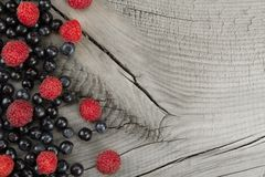 Blueberries and raspberries on wooden background. Healthy vegetarian food, diet Stock Photography