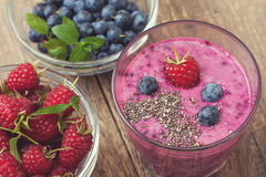 Blueberries raspberry  smoothies   (Top view ). Blueberries raspberry  smoothies with chia seeds in a glass of fresh blueberries for a healthy diet breakfast ( Stock Images