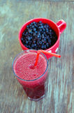 Blueberries in red cup and Royalty Free Stock Images