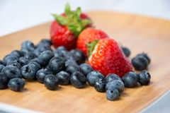 Blueberries. Refresh your breakfast with some strawberries and Blueberries Royalty Free Stock Photo