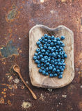 Blueberries in a rustic wooden serving dish over Royalty Free Stock Images