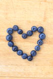 Blueberries in the shape of heart Royalty Free Stock Image