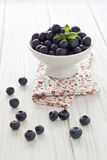Blueberries. In a small white bowl Stock Photo
