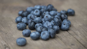 Blueberries. Some fresh and delicious blueberries on a rustic board Royalty Free Stock Photography