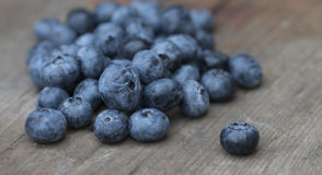 Blueberries. Some fresh and delicious blueberries on a rustic board Stock Photos