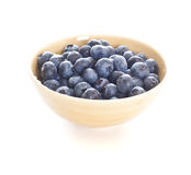 Blueberries spilling out of a bowl. Blueberries spilling out of a pottery bowl stock photos
