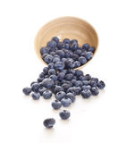 Blueberries spilling out of a bowl. Blueberries spilling out of a pottery bowl stock images
