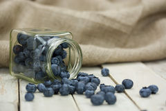 Blueberries spilt from a jar Royalty Free Stock Photography