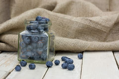 Blueberries spilt from a jar Royalty Free Stock Photos