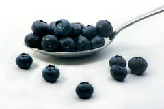 Blueberries on a spoon. Image of blueberries on a spoon Royalty Free Stock Photos