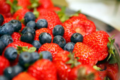 Blueberries and Strawberries. Tasty fresh blueberries and strawberries close up horizontal Stock Photography