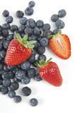 Blueberries and strawberries. On a white background Stock Images