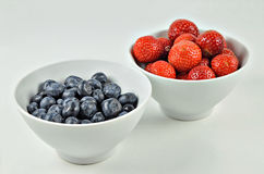 Blueberries and Strawberries in a Bowl Royalty Free Stock Photos