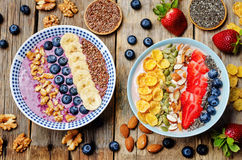 Blueberries and strawberries healthy smoothies breakfast bowls w Stock Photos
