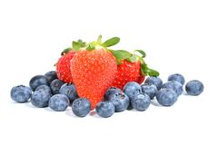 Blueberries and Strawberries. Pile of blueberries and strawberries  on white Royalty Free Stock Images