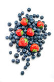 Blueberries and strawberries on white background Royalty Free Stock Photo